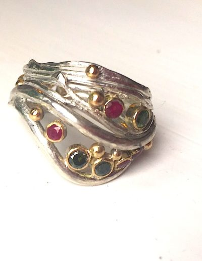 Silver and gold ring with rubies and green tourmalines